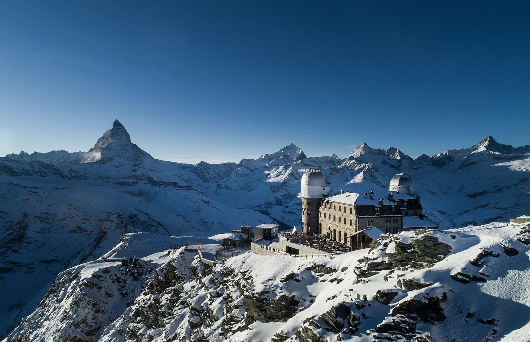 Slide 11 of 32: You can almost touch the stars at 3100 Kulmhotel Gornergrat. It's located more than 10,000 feet (3,100m)up Gornergrat ridge in the Swiss Alps. With unparalleled views of the Matterhorn, the hoteloffers anincredible mountain experience. There are 22 comfortable rooms, two restaurants and countless opportunities to make the most of your surroundings. Although anyone can book, it's advised not to stay at the hotel if you've visited a foreign country in the last 14 days before your stay, which also includes traveling to Switzerland.