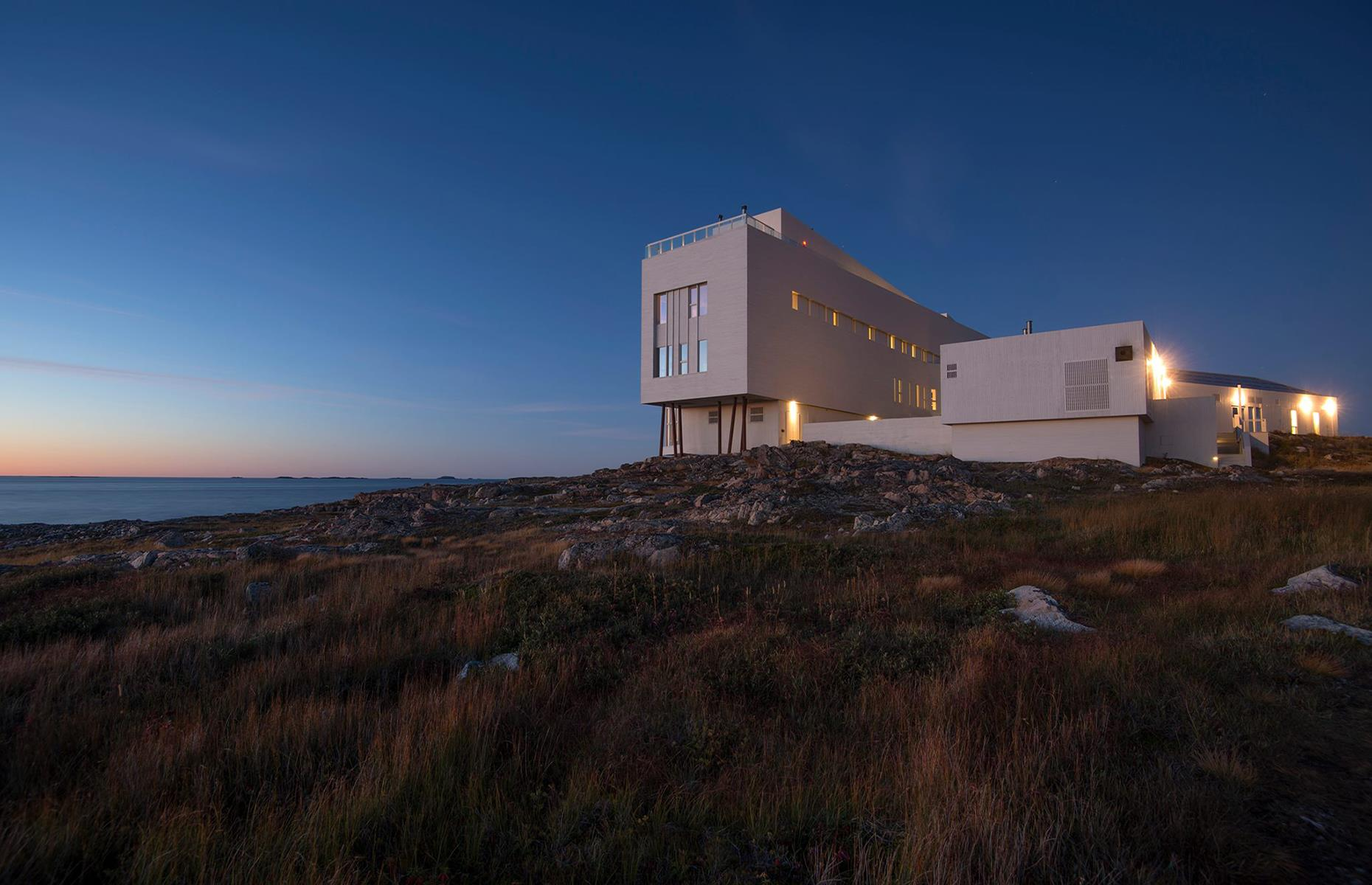 Slide 2 of 32: A minimalist masterpiece, Fogo Island Inn is tucked away from the worldin a traditional fishing village on the northern coast of Newfoundland's Fogo Island. The 29suites all come with access to a wood-fired sauna and rooftop hot tubs (both currently closed), plus a cinema, contemporary art gallery and a library specializing in Newfoundland's history. There arestrict health and safety proceduresin place.