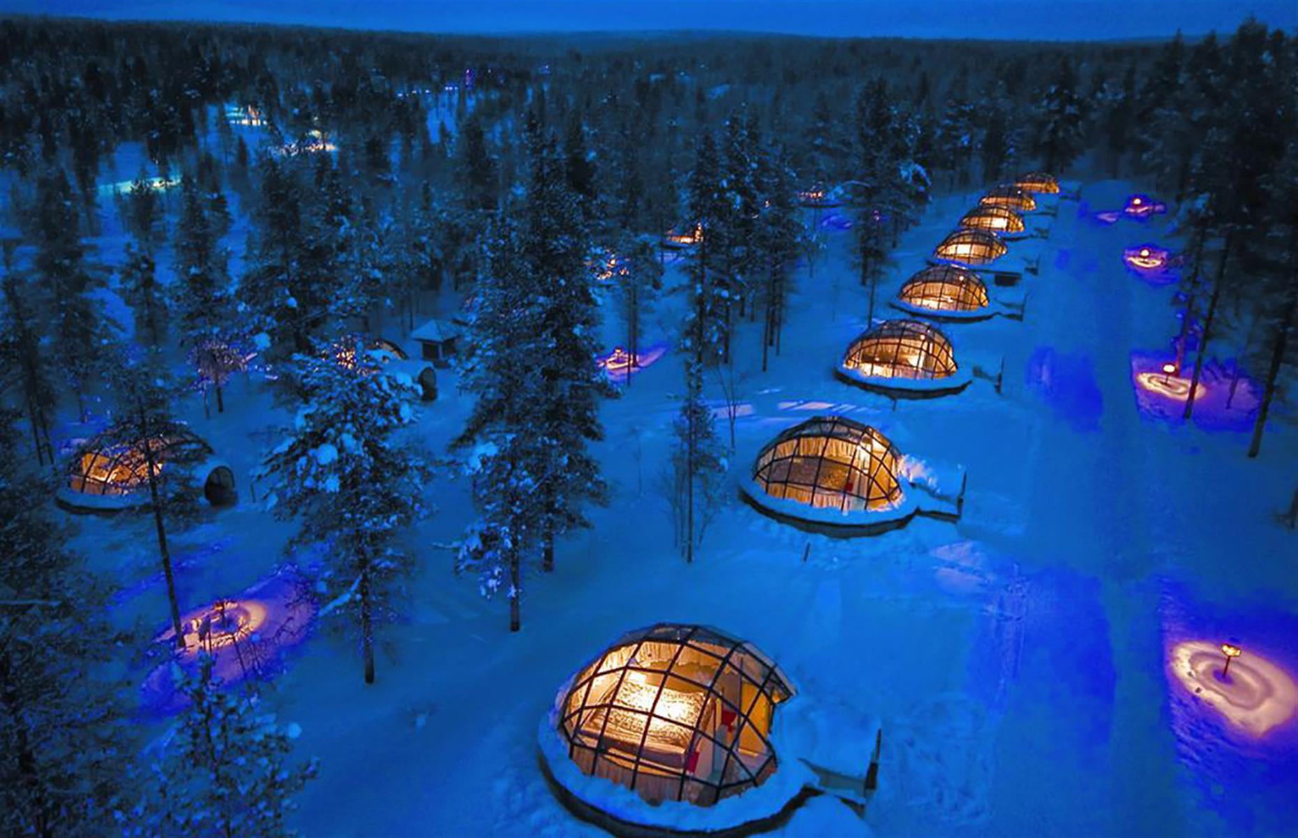 Slide 19 of 32: To live the ultimate Northern Lights dream, book a stay at the Kakslauttanen Arctic Resort in Lapland, Finland. Hidden deep in a forest, the glass igloos and traditional wooden chalets offer excellentviews, perfect for observing the light show in the sky. Some igloos even have a private sauna in the bathroom for you to make the most of your remote Arctic adventure.