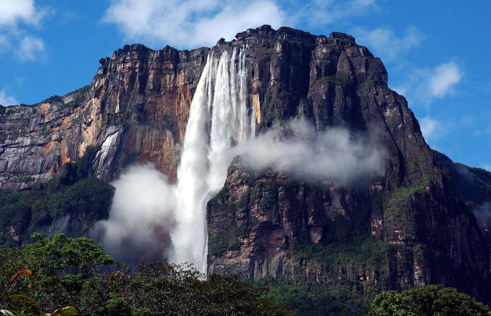 Slide 6 of 31: Technically, the largest known falls is the Denmark Strait cataract, which lies beneath the Atlantic Ocean. But, on land, Angel Falls takes the literal top spot as the world's tallest waterfall, crashing 3,212 feet (979m) over the edge of the Auyán-tepui mountain and into the Churun River. Its location in Canaima National Park is equally dramatic, with flat-topped mountains and mist-shrouded forest.