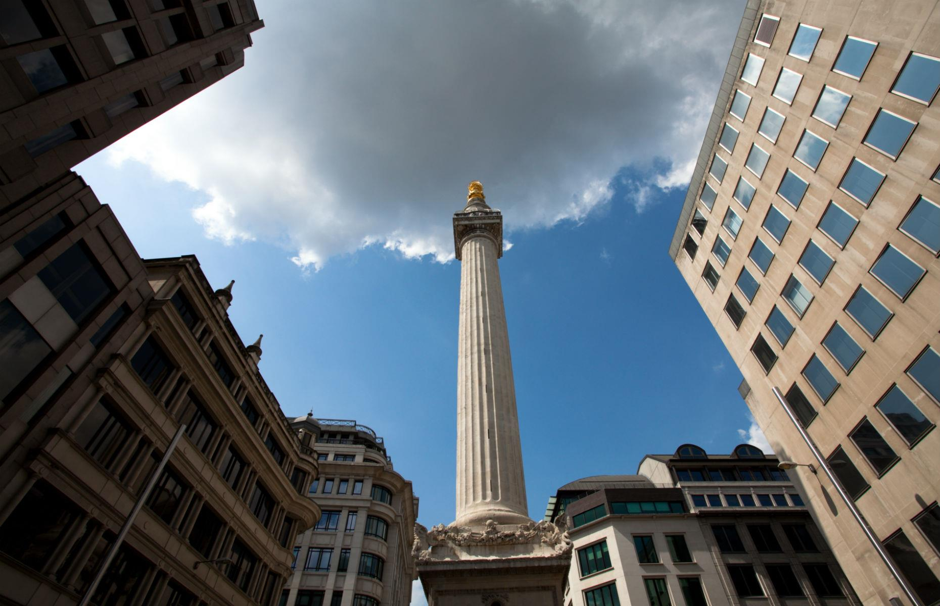 Slide 36 of 45: The Monument to the Great Fire of London stands at 202 feet (62m) tall in the City of London, near the northern end of London Bridge. Since the monument was completed in 1677, visitors have climbed its steps to enjoy views over England's capital. However in 1842 a cage had to be built around the gallery due to a few incidents of people jumping and falling off.