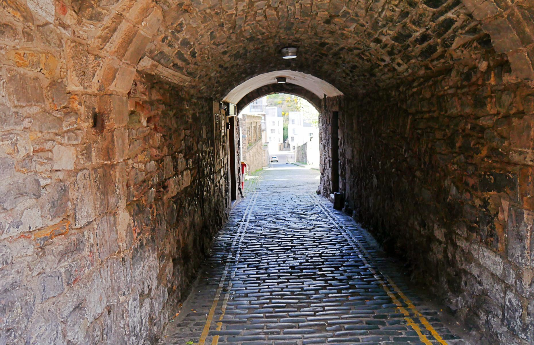 Slide 33 of 45: A number of the castle's hidden secrets relate to its military past and present. For example there's a network of tunnels and caves below Edinburgh whose purpose is shrouded in legends and stories. One tunnel constructed in the 1980s allows military vehicles to enter the castle without disrupting tourist visits.