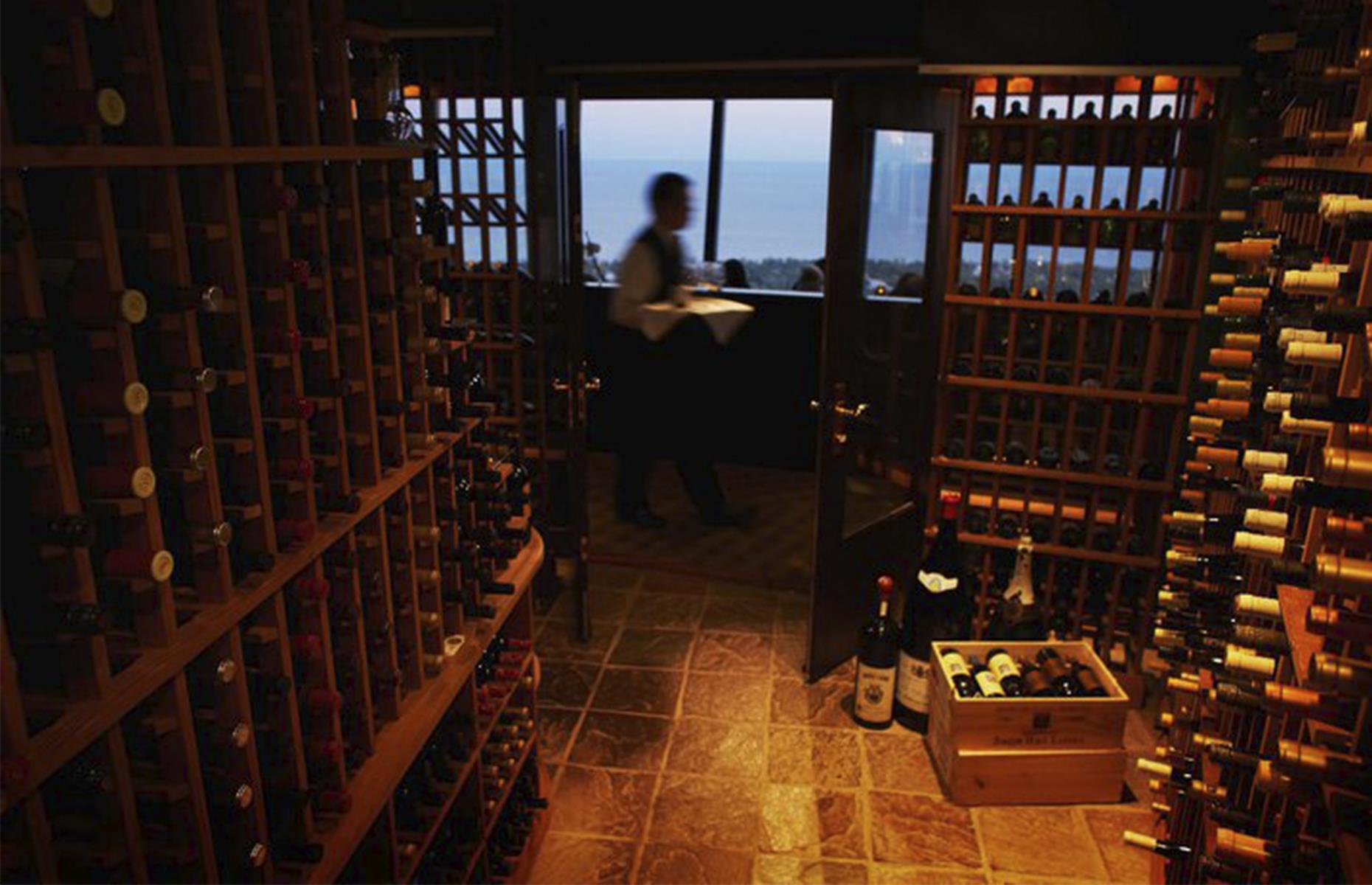 Slide 5 of 45: While most visitors know about the restaurant at the top of the tower, few know about 360Restaurant's wine cellar, which holds the Guinness World Record for being the world's highest. It looks just like a typical underground wine cellar and stores 9,000 bottles of wine within a humidity and temperature controlled room. The redwood rack room, with double cherry doors and a tasting table is a must-visit for wine connoisseurs. Read our guide to Toronto for tips on where to stay and what to do when it's safe to travel.