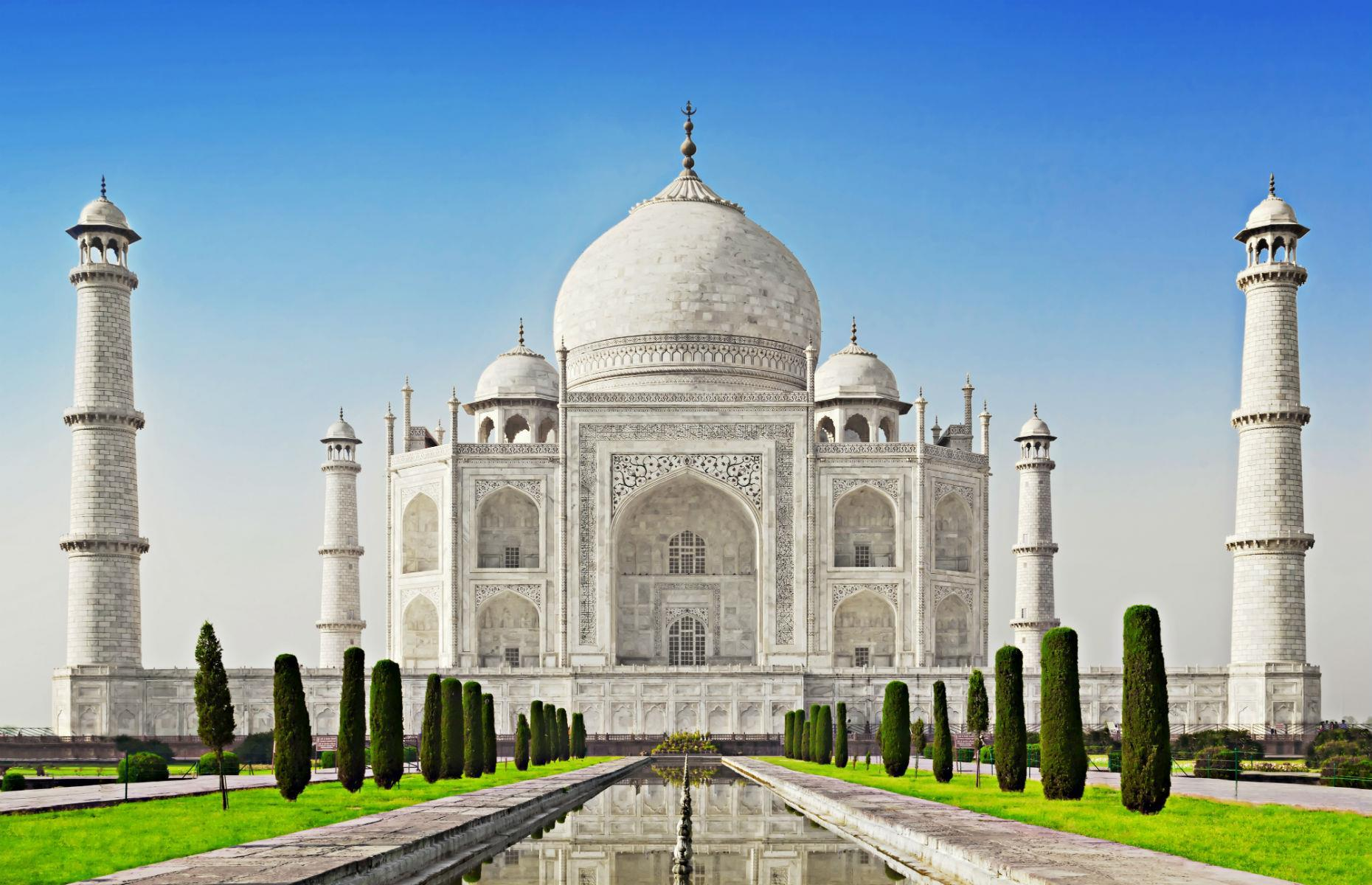 Slide 14 of 45: One of the most beautiful buildings on the planet, with the most romantic history, the Taj Mahal was built by the Mughal emperor Shah Jahān to immortalize his beloved wife Mumtaz Mahal after she died during childbirth.
