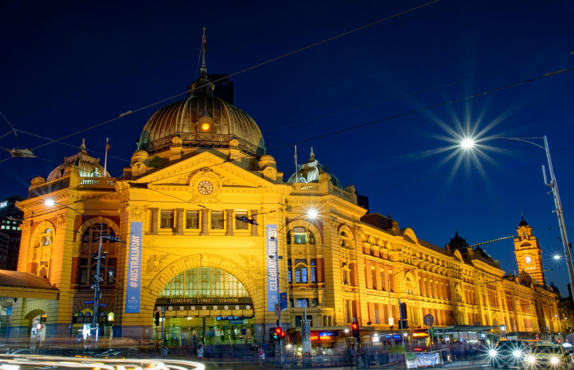 Slide 28 of 45: Melbourne's Flinders Street Station is one of the city's most beloved buildings. The first railway station built in an Australian city, the terminal has appeared in a number of movies and is well-known for the old-fashioned clocks displaying train departure times on its façade.