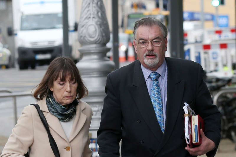 Ian Bailey wearing a                     suit and tie: Ian Bailey arrives at the Criminal                     Courts of Justice in Dublin with his partner Jules                     Thomas