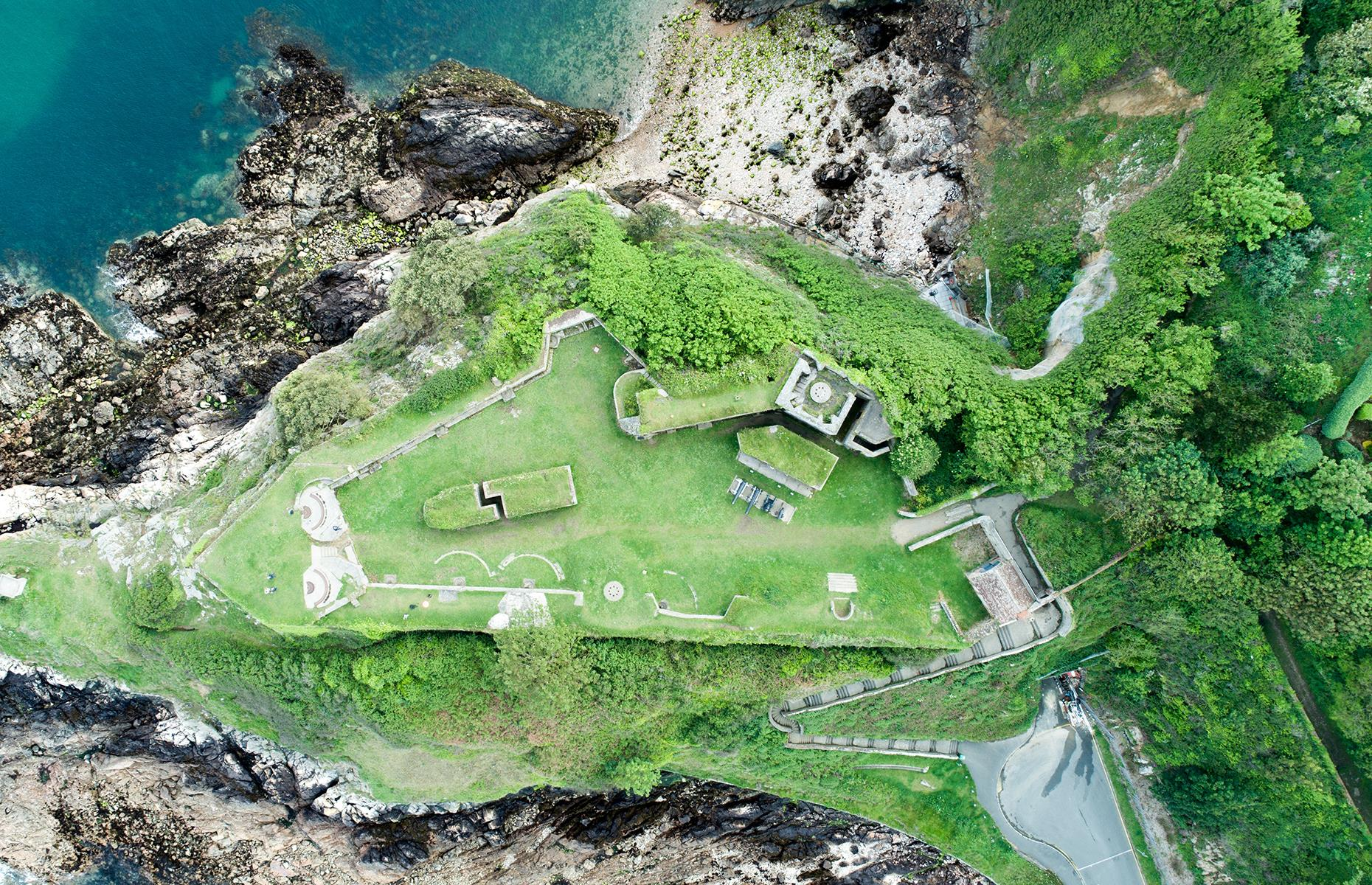 Slide 26 of 43: Built in 1780, Clarence Battery broods over the Channel Island of Guernsey. It's a well-preserved slice of history and this aerial snap shows the ruins of the defensive battery, as well as the rocky shoreline, the dense surrounding thickets and the lapping waves of the English Channel.