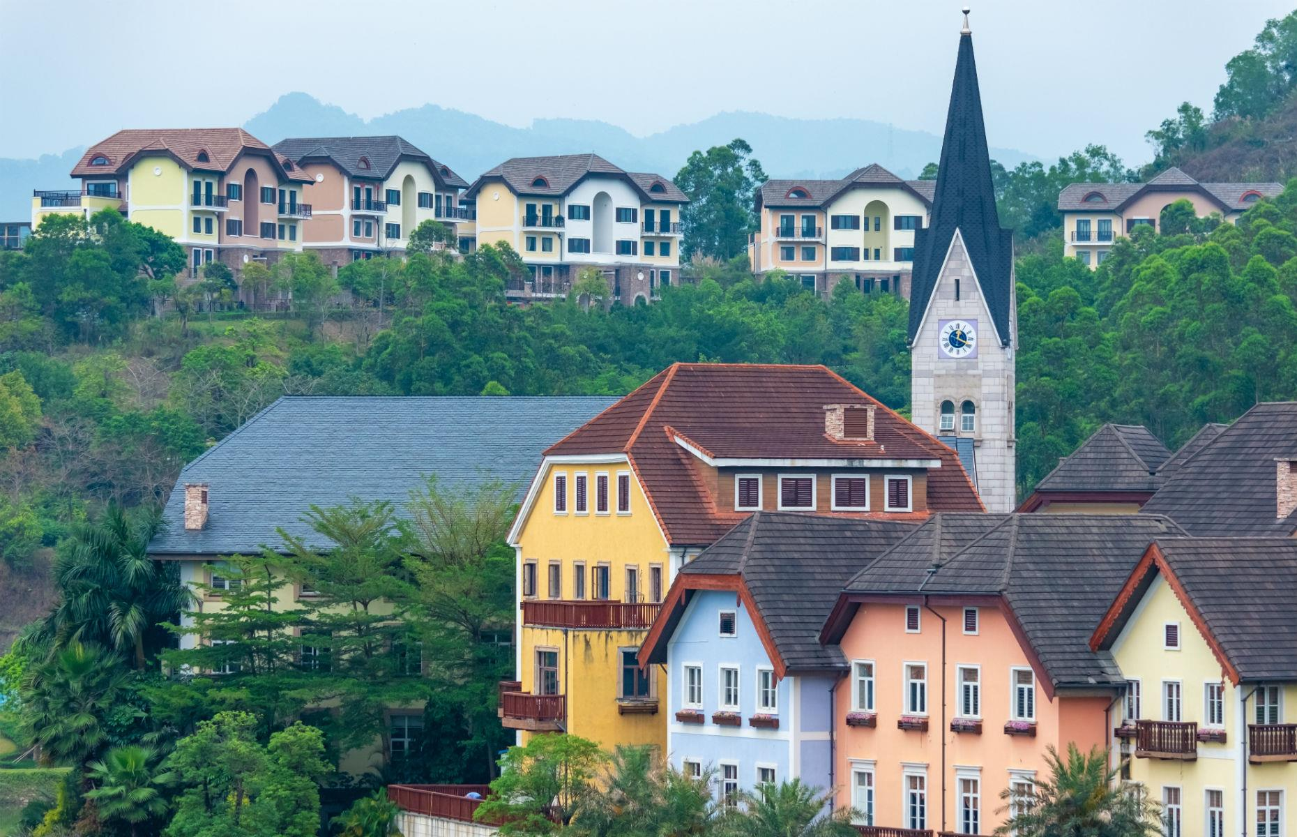 Slide 15 of 37: The Hallstatt clone (pictured here) was opened near Huizhou in 2012 at an estimated cost of $940 million. As well as Austrian-style houses, there's a village square and working church clock tower. Originally intended as housing for the rich, it's now a major tourist attraction.