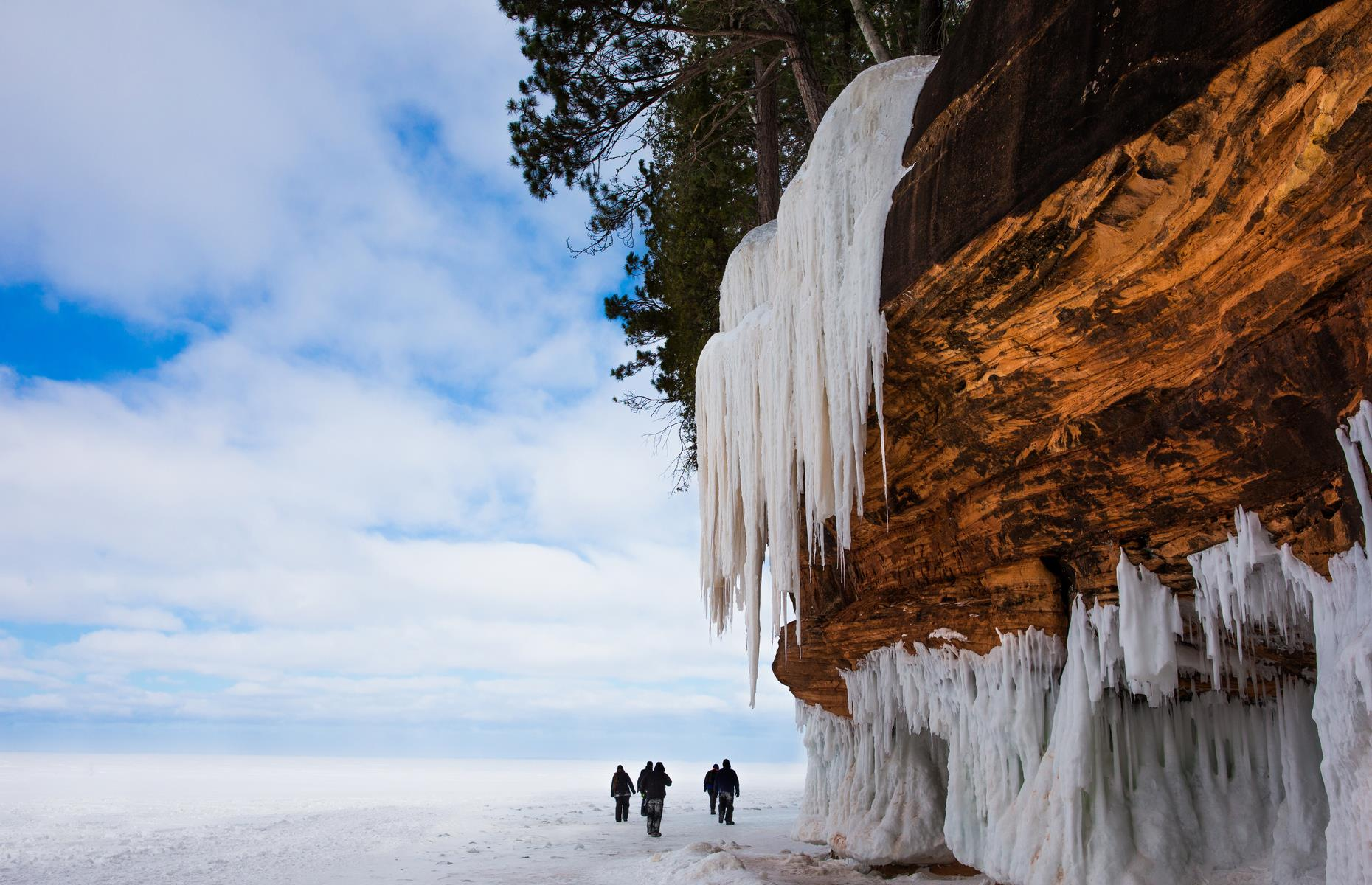 Slide 30 of 61: Apostle Islands National Lakeshore boasts all manner of natural wonders, from craggy rock formations and wind-battered cliffs to sandy strands – but none are more intriguing than the ice caves that form here each winter. The caves are accessible from a trail beginning at the Meyers Beach parking area and winding downwards (you'll walk up to sixmiles (9.6km) in total depending on how many of the caves you take in). Their opening times are entirely dependent on weather conditions and of course COVID-19 socheck the NPS website if you're planning a visit.