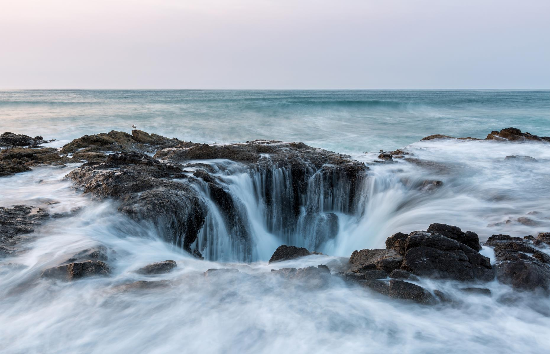 "Slide 42 of 61: Thor's Well is an apt name for this watery spectacle off the coast of Oregon. The frothing sinkhole in the Cape Perpetua Scenic Area plunges to around 20 feet (6m) and is often dubbed the ""drainpipe of the Pacific"". It's thought that it was once a sea cave, before the roof collapsed and the bubbling well was formed. Take photos from the shore, but remember not to get too close: especially at high tide, the phenomena can be as dangerous as it is beautiful."