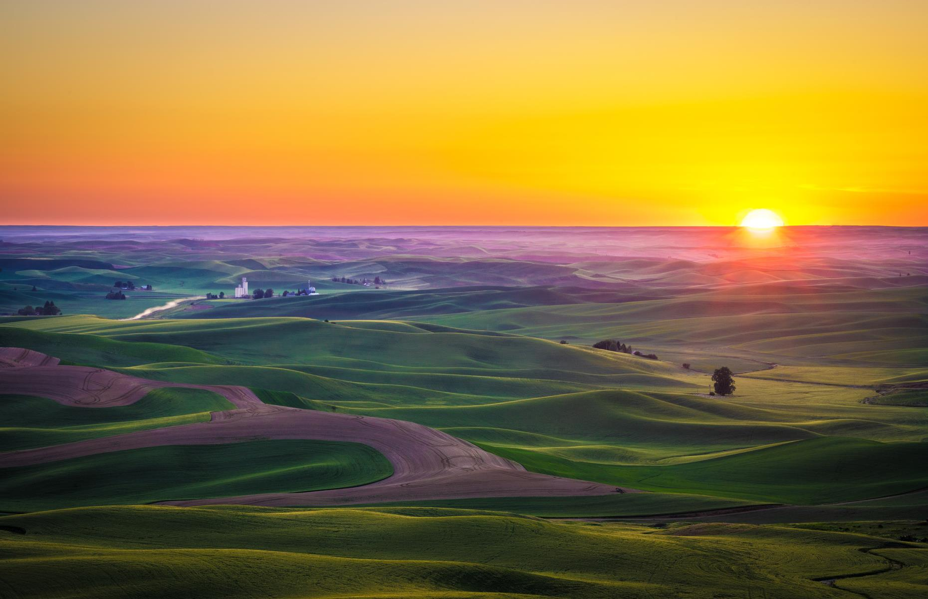 Slide 12 of 61: One of the premier agricultural regions in this part of the US, the Palouse area is all rolling hills and color-splashed meadows. It could easily be compared to Italy's Tuscany region too: it bears the same wave-like landscapes, blonde wheat fields and epic sunsets. Driving the Palouse Scenic Byway is a great way to discover the Washington portion of the region.