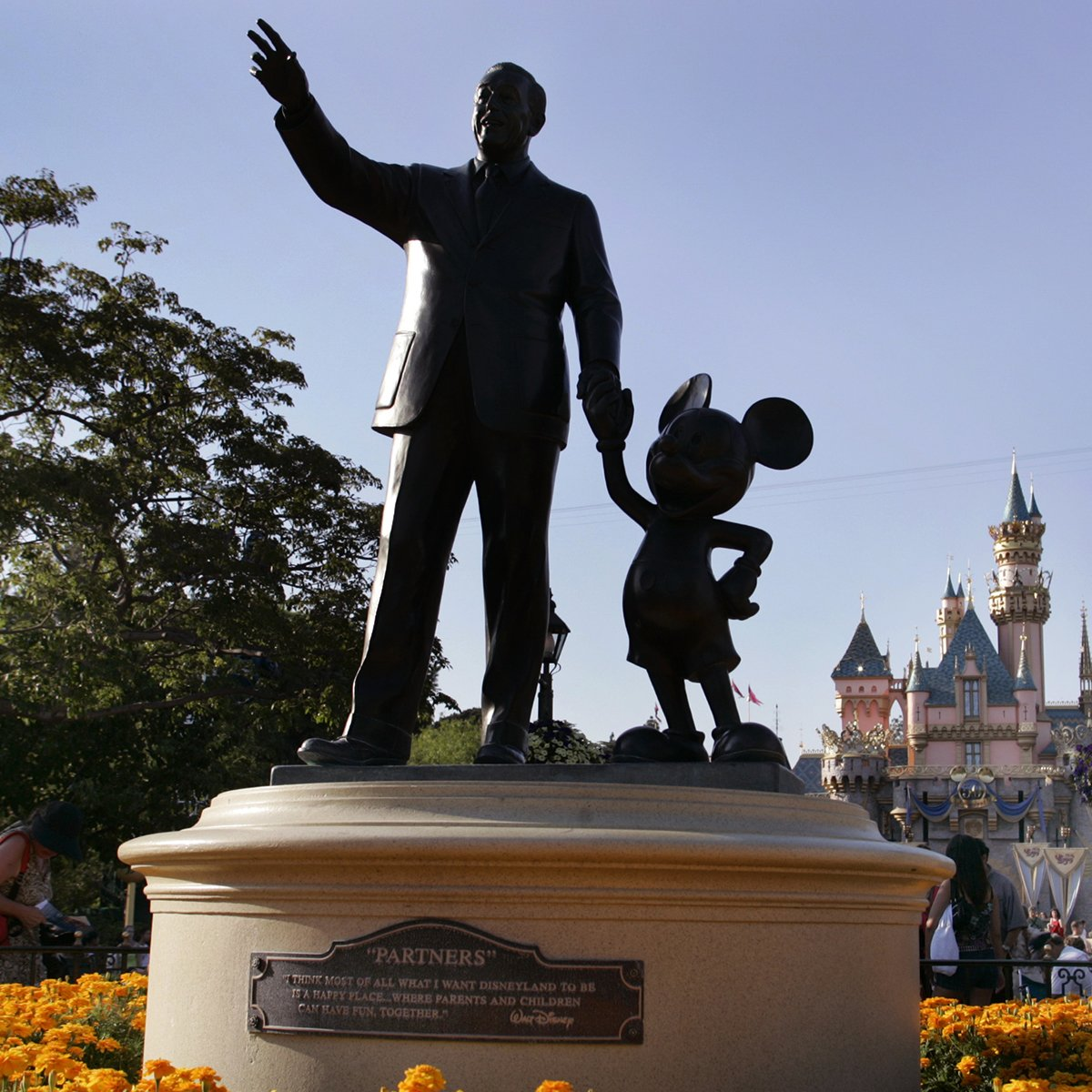 """Slide 14 of 19: Disneyland celebrated its 50th anniversary in 2005—and the """"Partners"""" statue depicting a hand-in-hand Walt Disney and Mickey Mouse remains a popular photo spot for park guests. Another park favorite? Grilled cheese. Get the recipe here."""