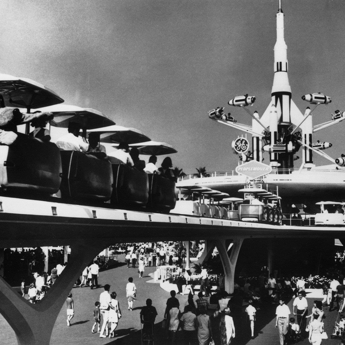 """Slide 4 of 19: Pluto catches a ride on Disneyland's """"People Mover"""" attraction—an innovative transportation ride that gave guests an overhead view of Tomorrowland."""