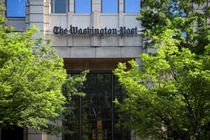 a tree in front of a building: WASHINGTON DC, MAY 24: The Washington Post Building at 1301 K St. NW in Washington DC, May 24, 2016. (Photo by John McDonnell / The Washington Post)