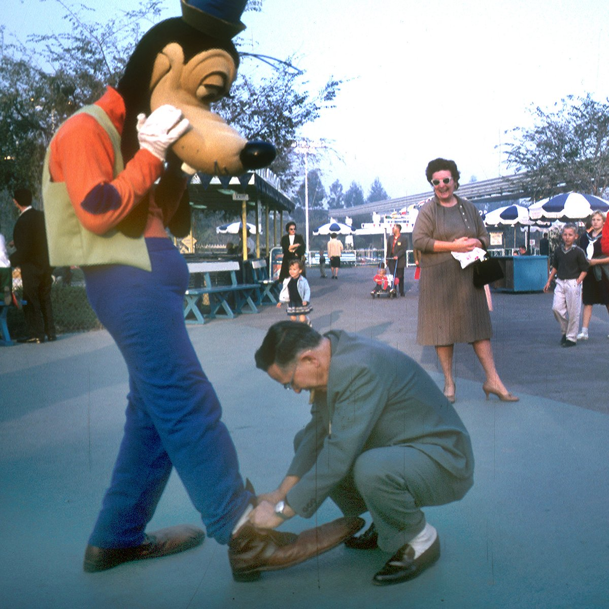 Slide 2 of 19: Oooh boy! A good samaritan steps in to lend a helping hand when Goofy's shoe came untied at Disneyland. Check out these 8 secret spots in Disney you never knew existed.
