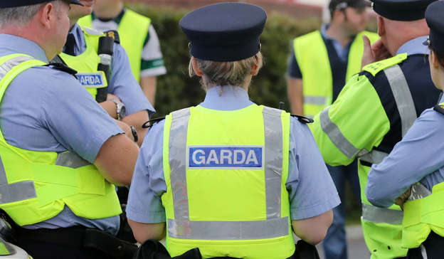 a group of people in uniform: Gardai have seized cocaine worth €126,500 with of cocaine and €6,000 of cannabis during a seizure in Kildare. Pic: Eamonn Farrell/RollingNews.ie