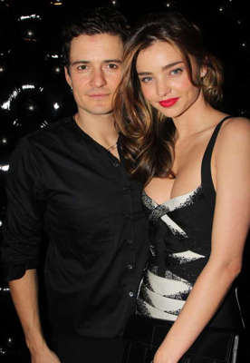 Orlando Bloom, Miranda Kerr posing for a picture: Miranda Kerr and Orlando Bloom