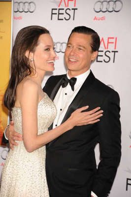 Angelina Jolie, Brad Pitt are posing for a picture: Brad Pitt and Angelina Jolie
