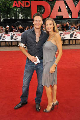 Gary Lucy standing posing for the camera: Gary Lucy and Natasha Gray
