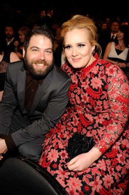 Adele et al. sitting next to a person: Adele and Simon Konecki