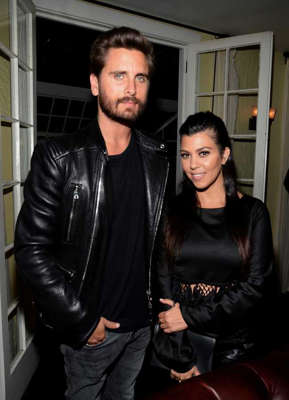 Scott Disick, Kourtney Kardashian are posing for a picture: Kourtney Kardashian and Scott Disick