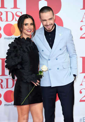 Cheryl Fernandez-Versini et al. posing for the camera: Liam Payne and Cheryl