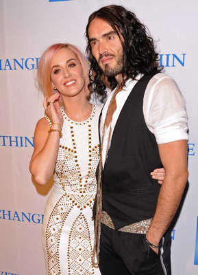 Katy Perry, Russell Brand posing for a picture: Katy Perry and Russell Brand