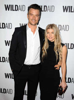 Josh Duhamel, Fergie are posing for a picture: Fergie and Josh Duhamel