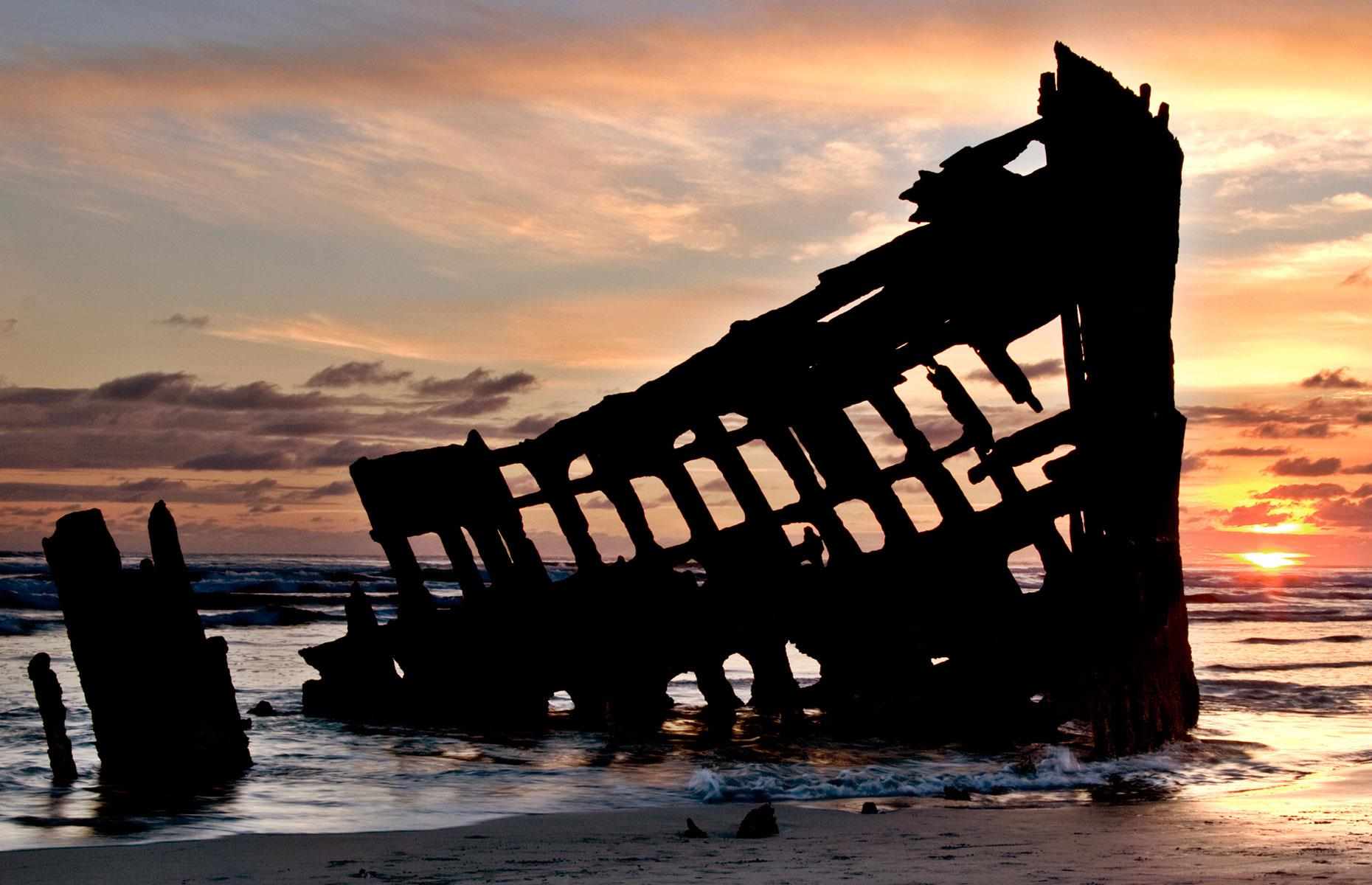 Slide 20 of 35: There are plenty of shipwrecks along the Oregon coastline and the morbidly named Graveyard of the Pacific – but perhaps the best known is the Peter Iredale, which can be found in the historic Fort Stevens State Park.
