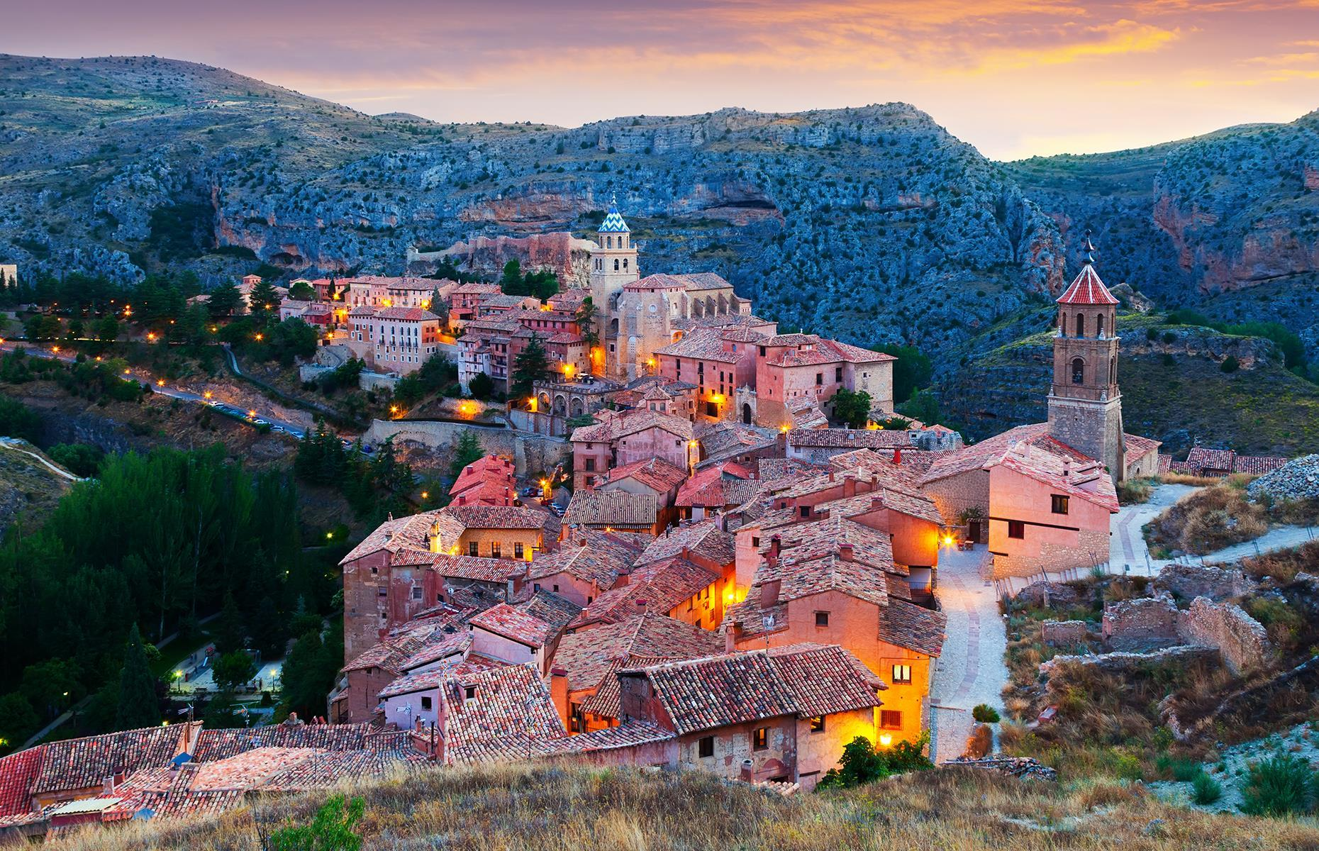 Slide 22 of 31: The tiny town of Albarracín sits prettily in the hills of central Spain, overlooking the Guadalaviar River. The towering medieval walls dominate the hillside while ruins of an old Moorish alcázar sit on a clifftop above the town, adding to the fairy-tale feel.