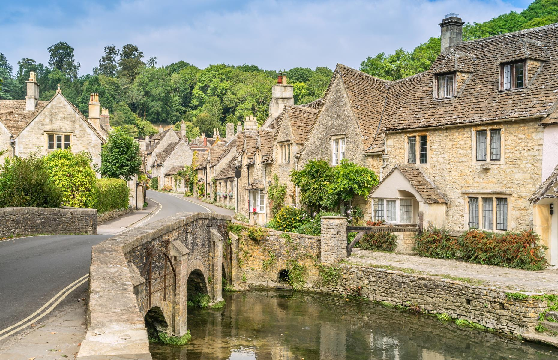 Slide 30 of 31: Villages don't come much more dreamy than this Cotswolds charmer with its honey-colored stone cottages, 13th-century church (whose faceless clock is thought to be one of the oldest in the country) and little stone bridges that cross the ambling River Bybrook. It's no wonder Castle Combe has caught the eye of movielocation scouts – credits include Stardust and Stephen Spielberg's War Horse.