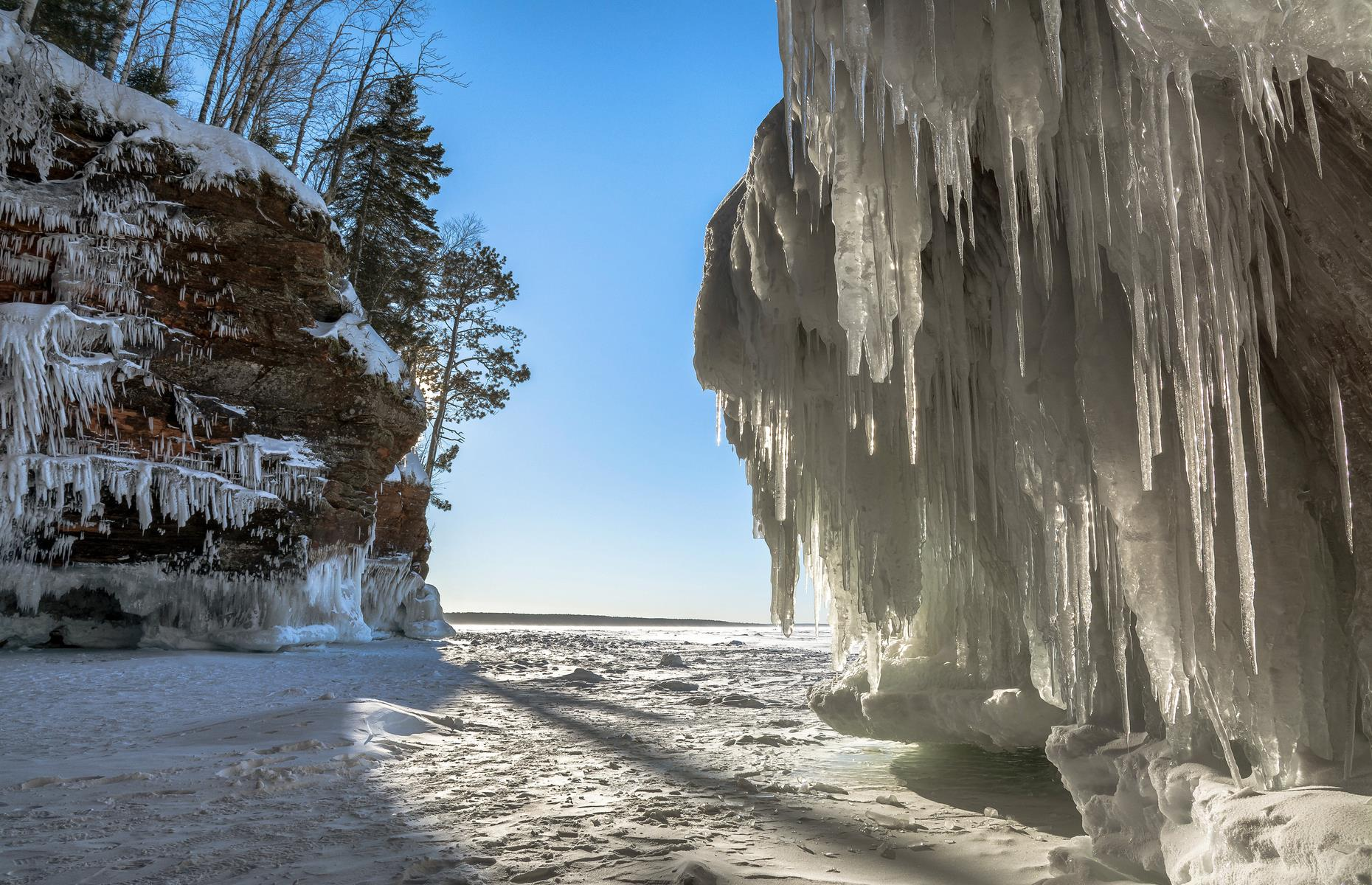 Slide 12 of 32: Apostle Islands National Lakeshore boasts all manner of natural wonders but none are more magical than the ice caves that form here in winter. Caverns drip with giant icicles and Lake Superior's ice is thick enough to walk on. Find more places you won't believe are in the USA.