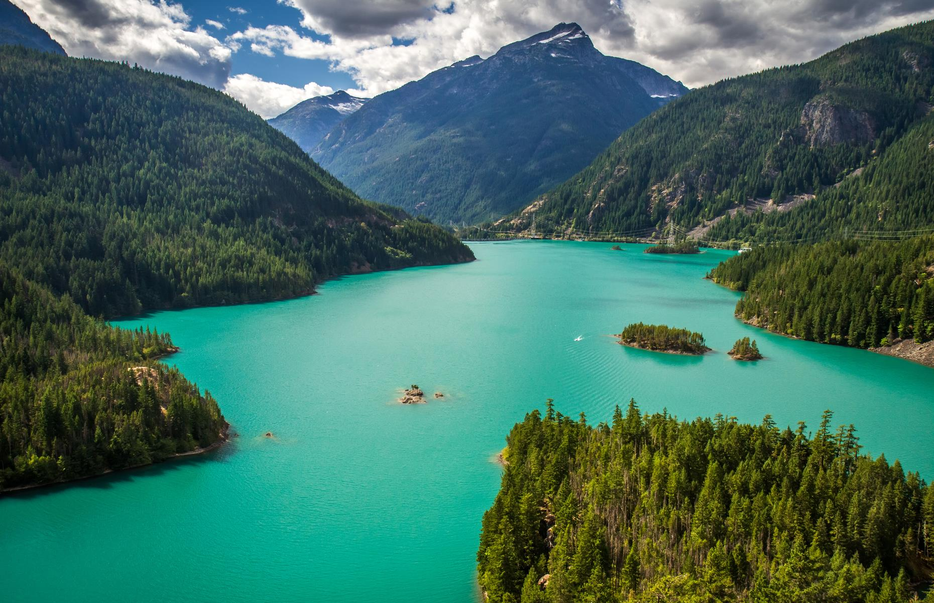 Slide 16 of 32: The beauty of North Cascades National Park is undeniable. Glacier crowns top mountain peaks, forested trails lead to tall waterfalls and lakes are the color of creamy turquoise. The park is home to grizzly bears, gray wolves and more than 200 species of bird.