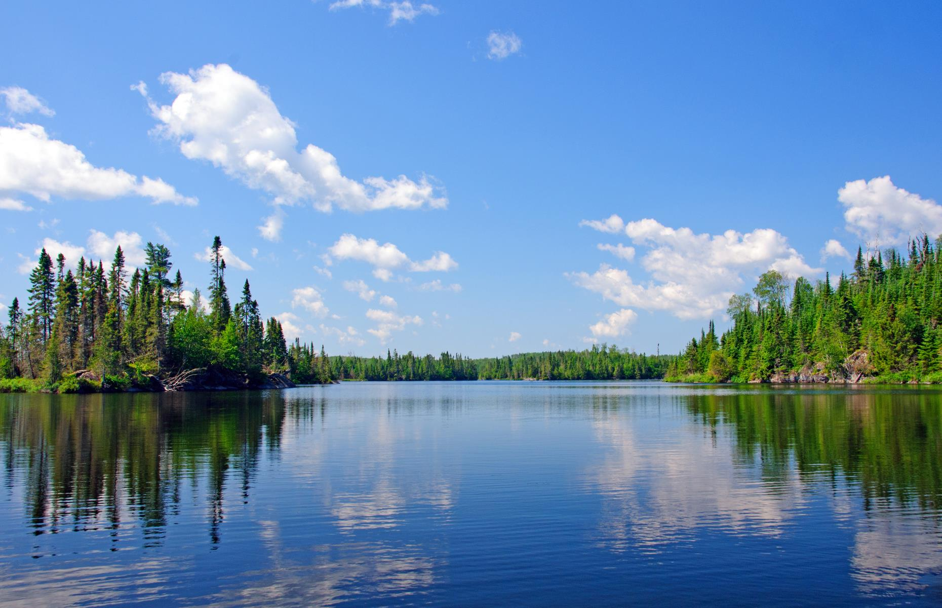 Slide 23 of 32: The Boundary Waters Canoe Area Wilderness stretches along Minnesota's border with Canada and is part of the Superior National Forest. With 1,000 lakes, rivers and streams, this watery expanse is incredibly peaceful. Black bears are known to hang out by the shore.
