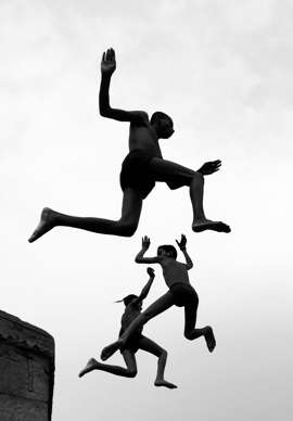 a man jumping in the air: Dimpy Bhalotia of the United Kingdom is the grand prize winner for her image Flying Boys. Shot on iPhone X