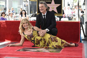 Goldie Hawn, Kurt Russell sitting on a table: The longtime lovebirds have starred in four films together: 1968's The One and Only, Genuine, Original Family Band, 1984's Swing Shift, 1987's Overboard and 2018's The Christmas Chronicles. They'll next be seen together in this year's upcoming Netflix film The Christmas Chronicles 2.