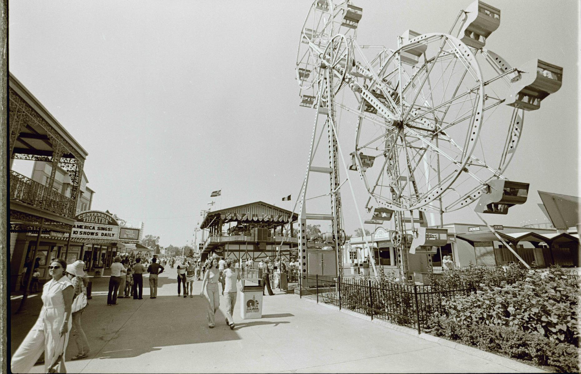Slide 14 of 35: Even today much of the action happens on the Main Midway (pictured), one of the oldest parts of the park. Cedar Point's Giant Sky Wheel, a vast double Ferris wheel (pictured right) debuted in the 1960s and delighted visitors right up until 1980. Meanwhile, the Centennial Theater (pictured back left) continues to entertain audiences as the Jack Aldrich Theater today.