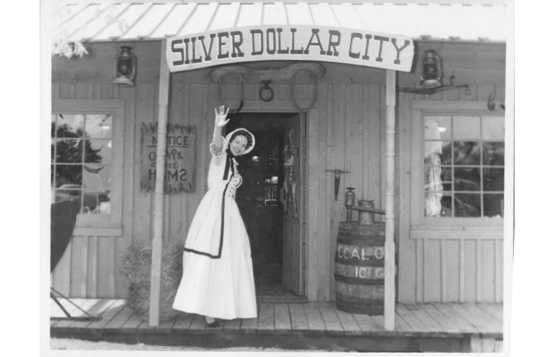 Slide 16 of 35: Thoroughly committed to its 1880s theme, Silver Dollar City had its start in the 1950s when the Herschend family set to work creating a replica mining town. In 1960, they opened the attraction, named Silver Dollar City, to the public – it was complete with an ice-cream parlor, a blacksmith's shop and a general store. The latter is pictured here in the 1960s.