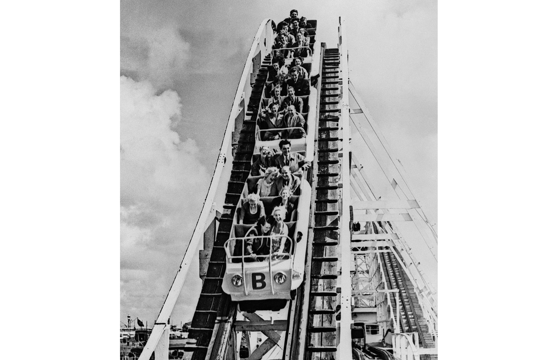 Slide 5 of 35: The tourist attraction is still going strong, and the Big Dipper, a wooden coaster first installed in the 1920s, is one ride that has become synonymous with the park. Here visitors in the 1950s brave one of the Dipper's epic drops.