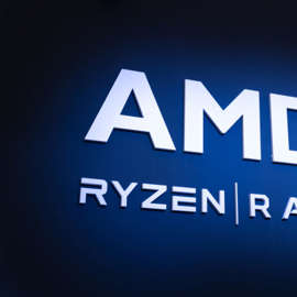 a close up of a sign: Advanced Micro Devices (AMD) logo on blue background with Ryzen and Radeon brands