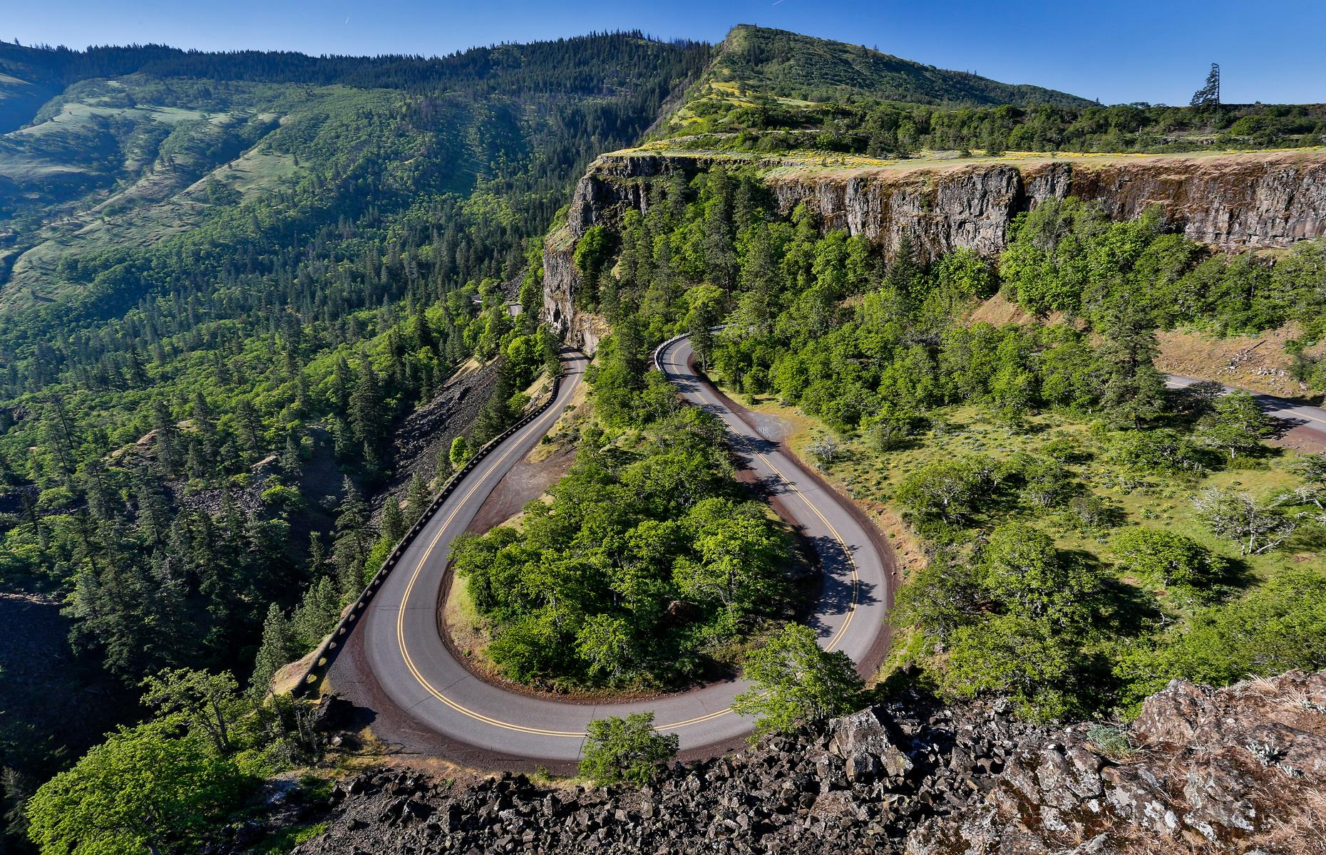 "Slide 23 of 31: Nicknamed ""King of Roads"", this designated National Historic Landmark runs along the vertiginous walls of the Columbia River Gorge for 70 breathtaking miles (113km). There are several scenic overlooks along the route, with the Portland Women's Forum State Scenic Viewpoint among the most popular thanks to vistas of basalt cliffs plunging into the river. Now discover the most beautiful weekend road trip in every state."
