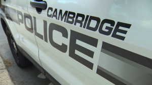 a car parked in front of a door: Cambridge police cruiser