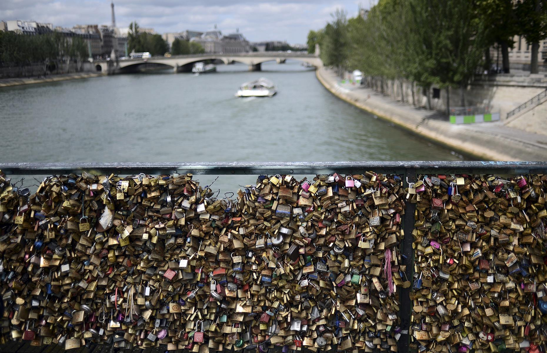 Slide 26 of 39: This quirky tradition saw tourists flocking to the City of Love to express their amour by signing theirs and their partner's names on padlocks, before attaching them to the Pont des Arts over the River Seine. The practice became so popular that at one point the bridge contained one million padlocks weighing around 45 tons.
