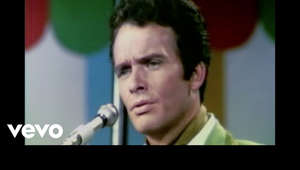 a screen shot of Merle Haggard: Music video by Merle Haggard performing Mama Tried (Live).