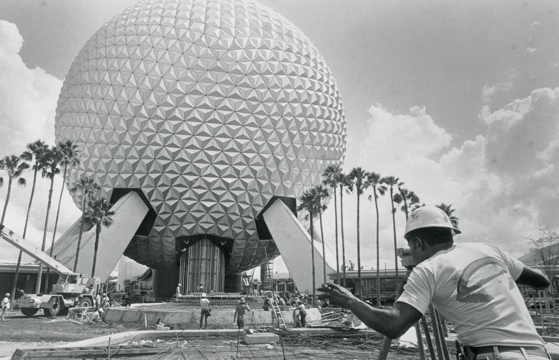 Slide 28 of 38: By the 1980s, Florida's Disney site had begun to expand into the magical juggernaut it is today. Curious, futuristic Epcot, which Disney had originally conceived to be a kind of utopian city and community, opened as a park in 1982. Its mammoth centerpiece – a geodesic sphere called Spaceship Earth – is pictured here at the center of the construction site in the early Eighties.