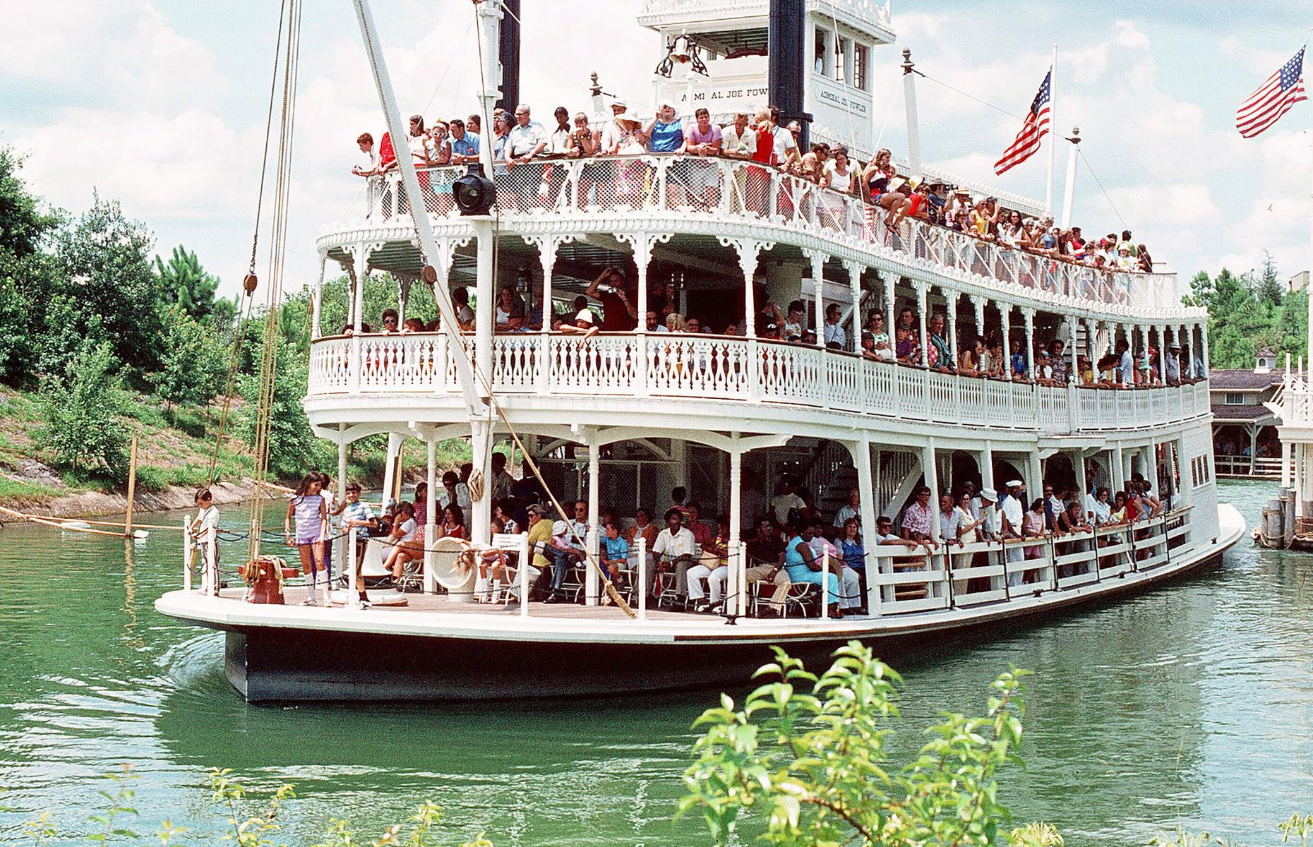 Slide 23 of 38: Today Walt Disney World Resort is Disney's flagship site, and is much larger than its California counterpart. Magic Kingdom was the first of four mammoth Floridian theme parks. The Admiral Joe Fowler Riverboat (pictured), named for the retired admiral who oversaw construction for the Disney parks, was an early amusement here.