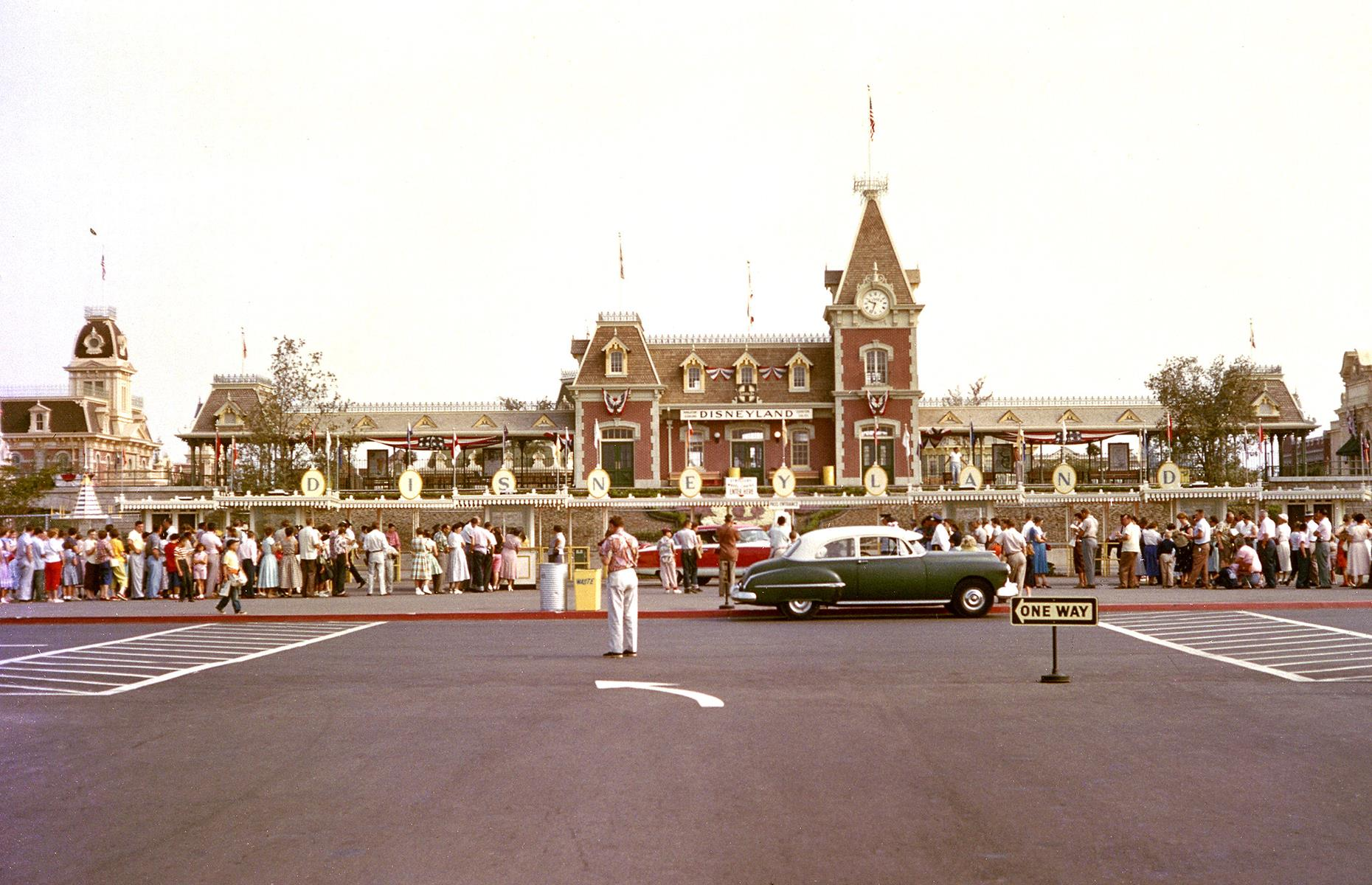 Slide 5 of 38: Such was the buzz around Disney's glittering new theme park that thousands more guests than the 6,000 invited turned up (reportedly some 28,000). This photo shows eager visitors queueing at Disneyland's main entrance on 17 July 1955. The huge influx of people meant the opening day didn't run quite as smoothly as planned, but luckily the public's fascination with this magical place was not marred.