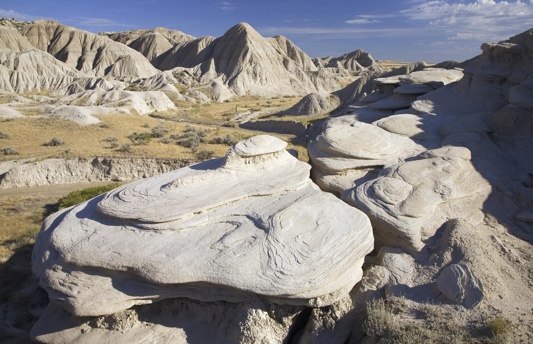 Slide 28 of 51: This badlands park is as oddly fascinating as its name suggests. The landscape of rock formations, from hoodoos to the eponymous 'toadstools', is often described as moon-like – but it also looks as if a few spaceships have landed on these plains. There's a campground area with toilets and day-use picnic tables. Hiking trails lead out from here and you can picnic en route, right amongthe rocks.