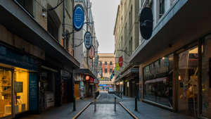 a narrow city street with a building in the background: The effect of the lockdown in Victoria on mental health is concerning Australia's top health officials.