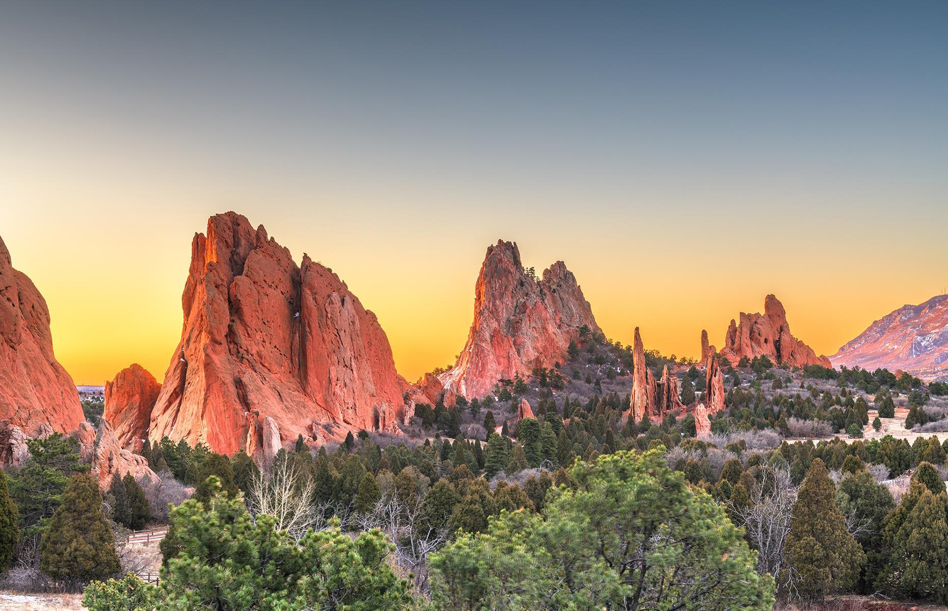 Slide 47 of 100: Garden of the Gods is an apt name for this awesome natural landmark in central Colorado. The sandstone formations here dot the park's 1,300-acre expanse like rocky red castles, and were formed over a course of about 300 million years. The 14,115-foot (4,302m) mountain Pikes Peak presides over it all.